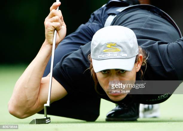 Camilo Villegas of Colombia lines up a shot on the 15th hole during the weatherdelayed first round of the BMW Championship on September 5 2008 at...