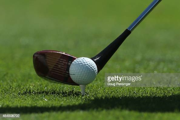 Camilo Villegas of Colombia lines up his shot as he uses a vintage persimmon wood driver to hit a tee shot on the first hole during practice ahead of...