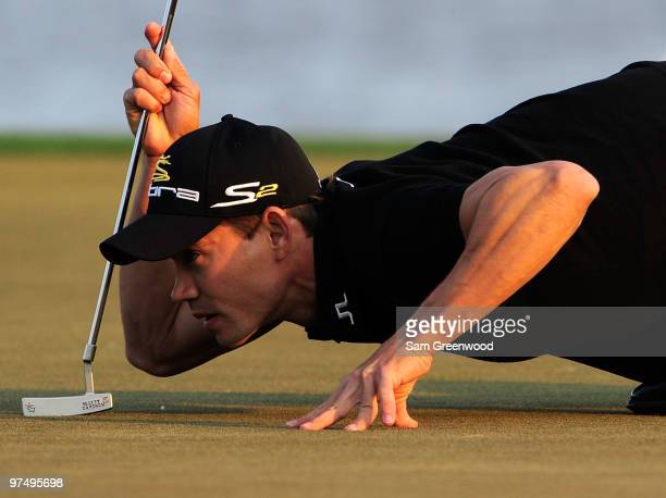 Camilo Villegas of Colombia looks over a putt on the 18th hole during the third round of the Honda Classic at PGA National Resort And Spa on March 6...