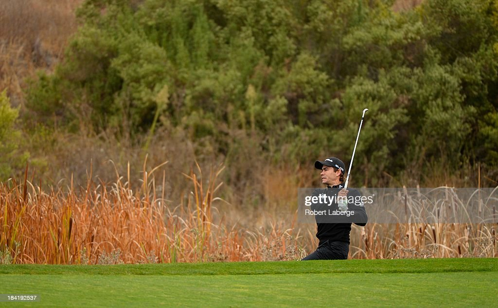 <a gi-track='captionPersonalityLinkClicked' href=/galleries/search?phrase=Camilo+Villegas&family=editorial&specificpeople=561721 ng-click='$event.stopPropagation()'>Camilo Villegas</a> of Colombia makes a shot out of the rough on the 17th hole during round two of the Frys.com Open at the CordeValle Golf Club on October 11, 2013 in San Martin, California.