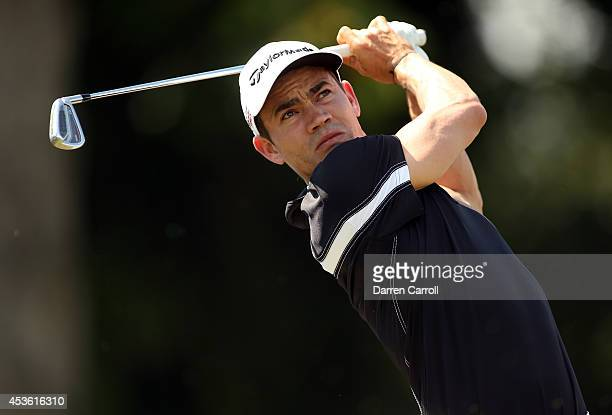 Camilo Villegas of Colombia plays his tee shot on the 16th hole during the first round of the Wyndham Championship at Sedgefield Country Club on...