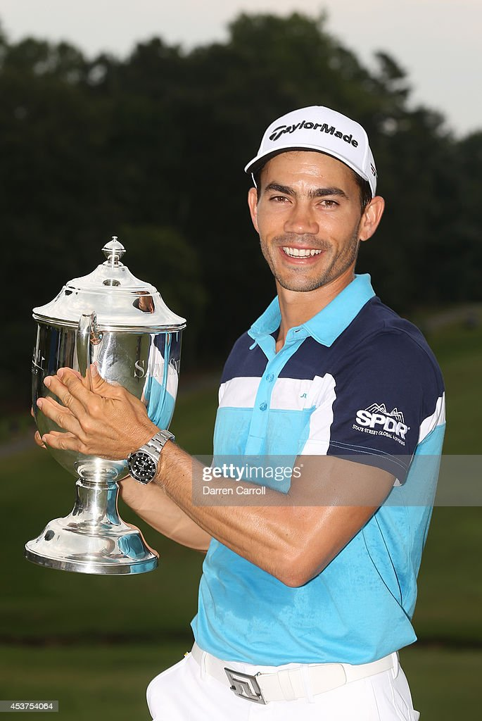 <a gi-track='captionPersonalityLinkClicked' href=/galleries/search?phrase=Camilo+Villegas&family=editorial&specificpeople=561721 ng-click='$event.stopPropagation()'>Camilo Villegas</a> of Colombia poses with the Sam Snead Cup after winning the Wyndham Championship at Sedgefield Country Club on August 17, 2014 in Greensboro, North Carolina.
