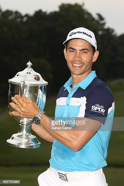 Camilo Villegas of Colombia poses with the Sam Snead Cup after winning the Wyndham Championship at Sedgefield Country Club on August 17 2014 in...