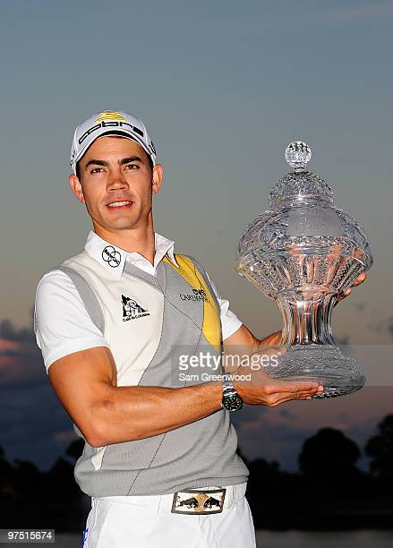 Camilo Villegas of Colombia poses with the trophy after winning the Honda Classic at PGA National Resort And Spa on March 7 2010 in Palm Beach...