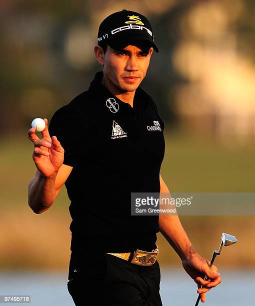Camilo Villegas of Colombia reacts to a par putt on the 18th hole during the third round of the Honda Classic at PGA National Resort And Spa on March...