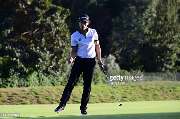 Camilo Villegas of Colombia reacts to his birdie putt on the eighth hole during round one of the Northern Trust Open at Riviera Country Club on...