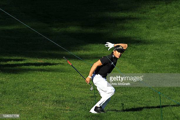 Camilo Villegas of Colombia runs under a rope to see his second shot out of the rough on the 11th hole during round one of the 2010 RBC Canadian Open...