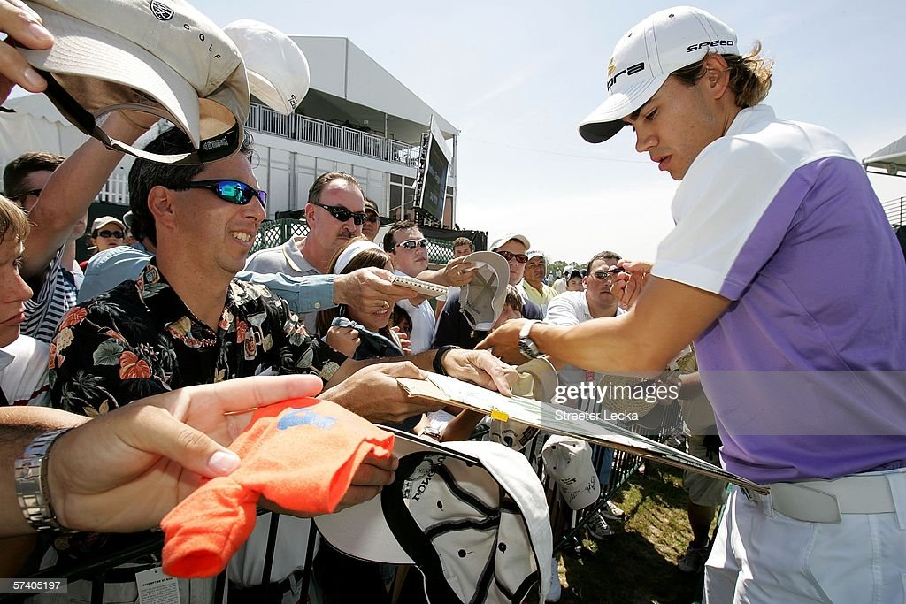 Camilo Villegas of Colombia signs autographs for fans after finishing the final round of the Shell Houston Open on April 23 2006 at Redstone Golf...