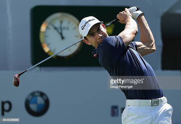 Camilo Villegas of Colombia uses a vintage persimmon wood driver to hit a tee shot on the first hole during practice ahead of the BMW Championship at...