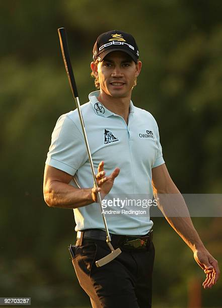 Camilo Villegas of Colombia walks towards his ball on the eighth hole during the proam prior to the start of the WGCHSBC Champions at Sheshan...
