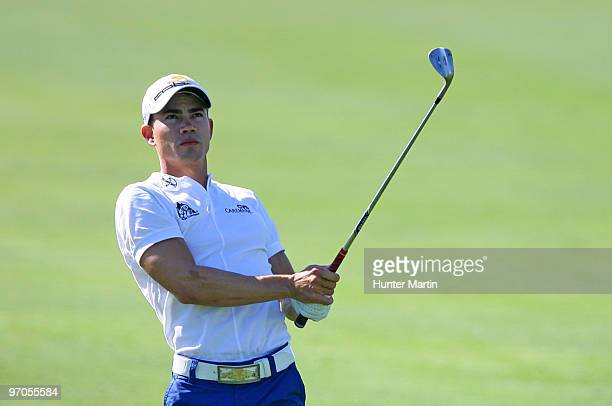 Camilo Villegas of Colombia watches his second shot on the 18th hole during the first round of the Waste Management Phoenix Open at TPC Scottsdale on...