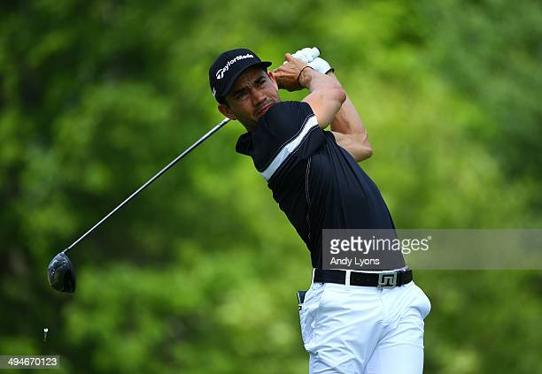 Camilo Villegas of Colombia watches his tee shot on the 18th hole during the second round of the Memorial Tournament presented by Nationwide...