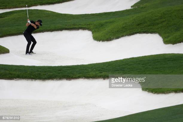 Camilo Villegas of Columbia plays a shot from a bunker on the 17th hole during round two of the Wells Fargo Championship at Eagle Point Golf Club on...
