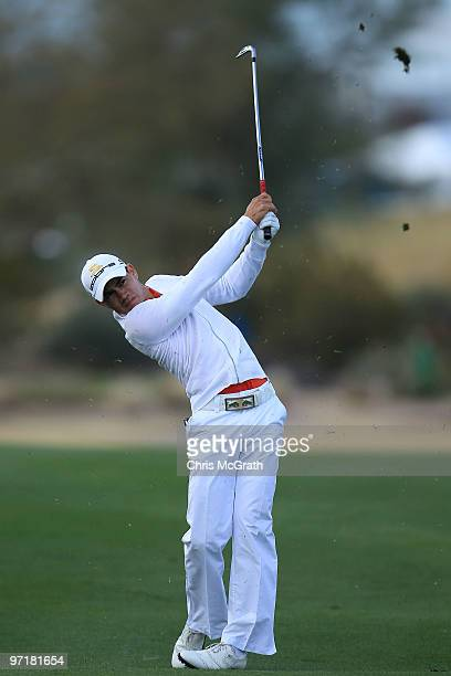 Camilo Villegas of Columbia plays his second shot on the 14th hole during the final round of the Waste Management Phoenix Open at TPC Scottsdale on...