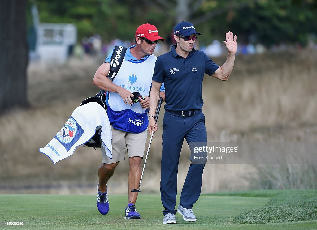 Camilo Villegas of Columbia walks with his caddie to the 18th green during the third round of The Barclays at Plainfield Country Club on August 29, 2015 in Edison, New Jersey.