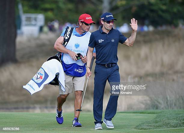 Camilo Villegas of Columbia walks with his caddie to the 18th green during the third round of The Barclays at Plainfield Country Club on August 29...
