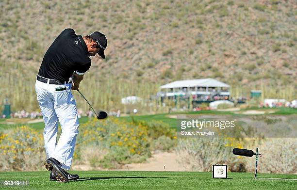 Camilo Villegas of Coumbia plays his tee shot on the 14th hole during round two of the Accenture Match Play Championship at the RitzCarlton Golf Club...