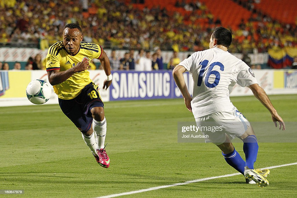 Camilo Zuniga #18 of Colombia brings the ball towards the net while being defended by <a gi-track='captionPersonalityLinkClicked' href=/galleries/search?phrase=Marco+Pappa&family=editorial&specificpeople=4651161 ng-click='$event.stopPropagation()'>Marco Pappa</a> #16 of Guatemala on February 6, 2013 at SunLife Stadium Stadium in Miami Gardens, Florida.
