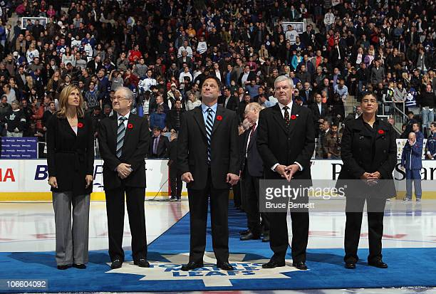 Cammi Granato Jim Devellano Dino Ciccarelli Bob Seaman and Angela James are honored for their induction into the Hockey Hall of Fame prior to the...