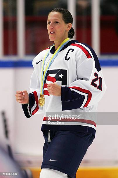 Cammi Granato of team USA celebrates with her gold medal after defeating team Canada in a shootout to win the IIHF World Women's Championships gold...