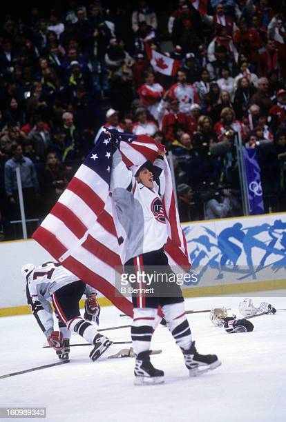 Cammi Granato of Team USA celebrates with the American Flag after the women's gold medal match against Team Canada at the 1998 Nagano Winter Olympics...