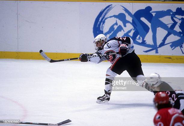 Cammi Granato of Team USA shoots during the women's first round match against Team Canada at the 1998 Nagano Winter Olympics on February 14 1998 at...