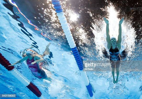 Cammile Adams and Maya DiRado of the United States compete in a preliminary heat for the Women's 400 Meter Individual Medley during Day One of the...