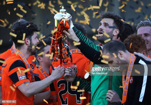 Cammy Bell of Dundee United holds the trophy a loft during the IrnBru Cup Final between Dundee United and St Mirren at Fir Park on March 25 2017 in...