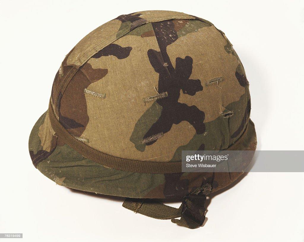 Camouflage army helmet : Stock Photo