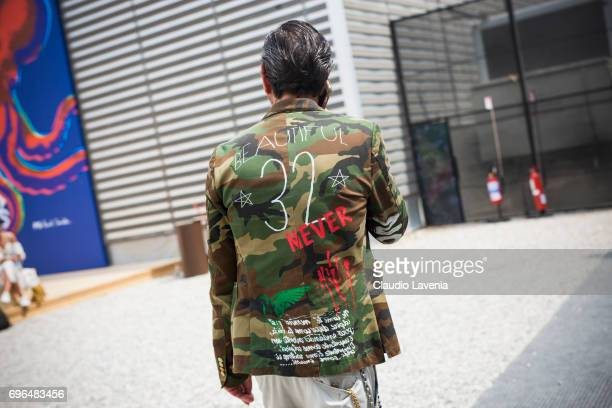 Camouflage jacket is seen during Pitti Immagine Uomo 92 at Fortezza Da Basso on June 15 2017 in Florence Italy