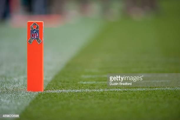 A camouflage ribbon and the NFL logo are seen on a goal line pylon during the NFL's 'Salute to Service' campaign during a game between the Denver...