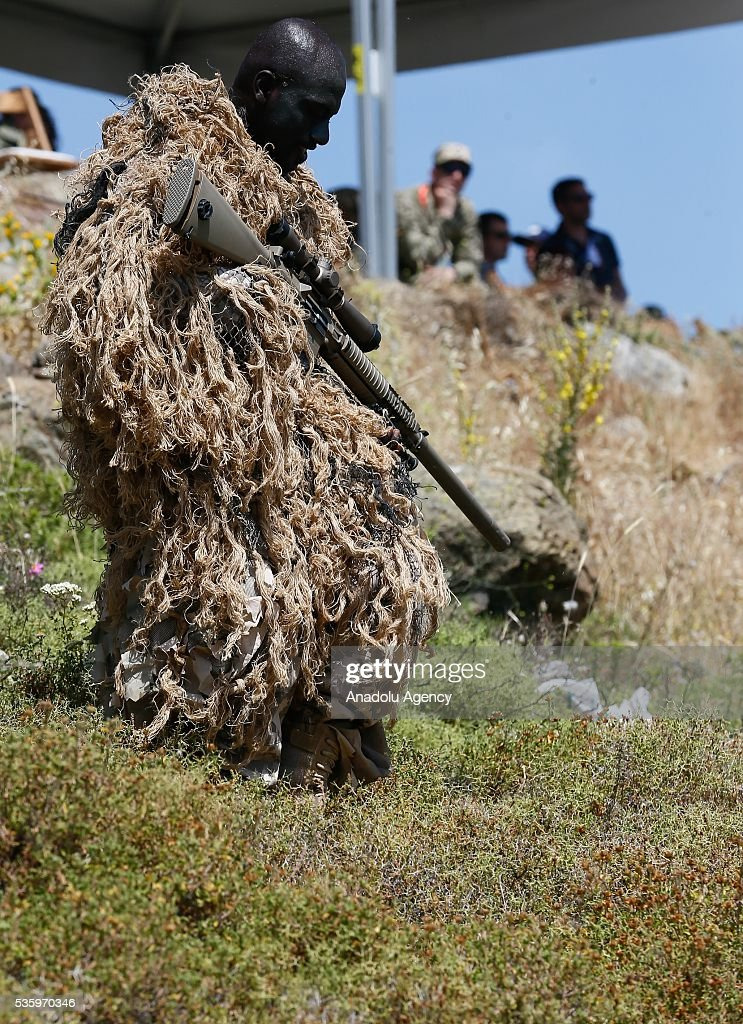 Camouflaged soldier is in action during the Efes-2016 Combined Joint Live Fire Exercise at Seferihisar district of Izmir, Turkey on May 31, 2016. The Turkish-led multinational military exercises, Efes-2016 which started at 04 May and will be finished at 04 June 2016, aims to train participating units and staff in planning and conducting combined and joint operations, including logistics and command-control as well as to improve the level of interoperability among headquarters and forces.