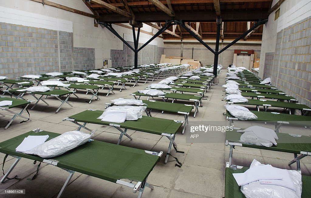 Camp beds are lined up in the sleeping quarters at a temporary Army barracks at Tobacco Dock a former shopping centre in east London on July 19 2012...