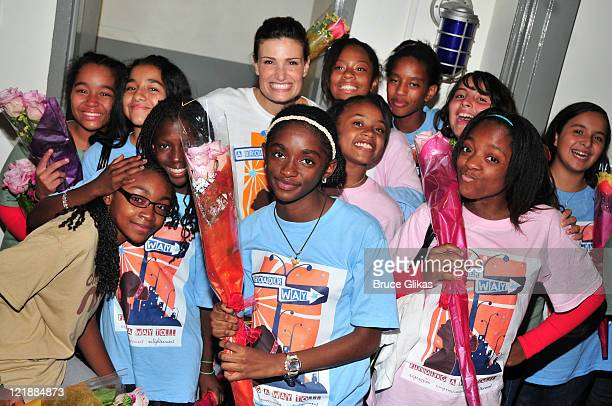 Camp BroaderWay Founder Idina Menzel poses backstage with students from Camp BroaderWay at the Miller Theatre at Columbia University on August 22...