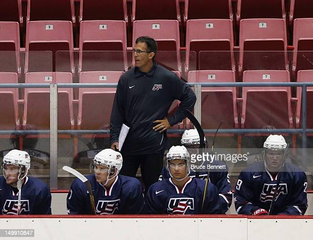 Camp coach Tony Granato handles bench duties for the USA Blue Squad as they play against Team Finland at the USA hockey junior evaluation camp at the...