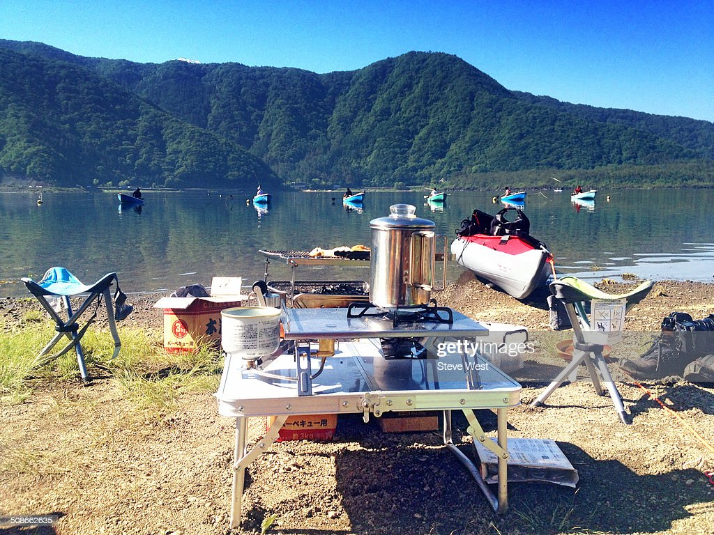 Camp equipment in front of lake near Mt. Fuji.