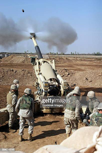 Camp Fallujah, Iraq, November 11, 2004 - U.S. Marines engage enemy targets with an M-198 155mm Howitzer.