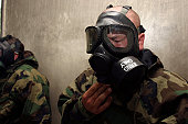 Camp Hansen, Okinawa, Japan, April 21, 2006 - A field radio operator clears CS gas from his gas mask at the gas chamber.