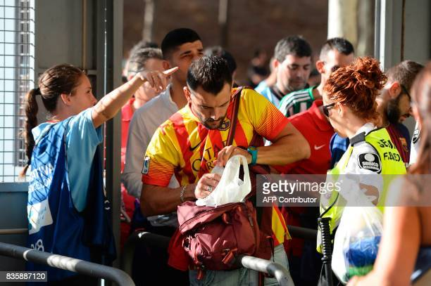 Camp Nou security members check bags of football fans before the Spanish league footbal match FC Barcelona vs Real Betis at the Camp Nou stadium in...