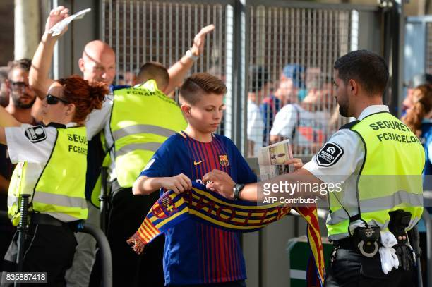 Camp Nou security members check football fans before the Spanish league footbal match FC Barcelona vs Real Betis at the Camp Nou stadium in Barcelona...