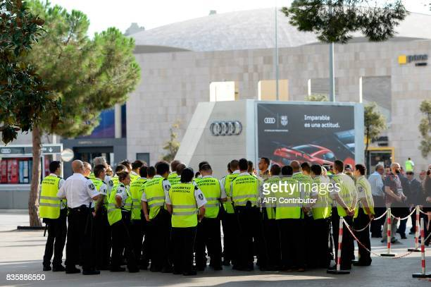 Camp Nou security members gather before the Spanish league footbal match FC Barcelona vs Real Betis at the Camp Nou stadium in Barcelona on August 20...