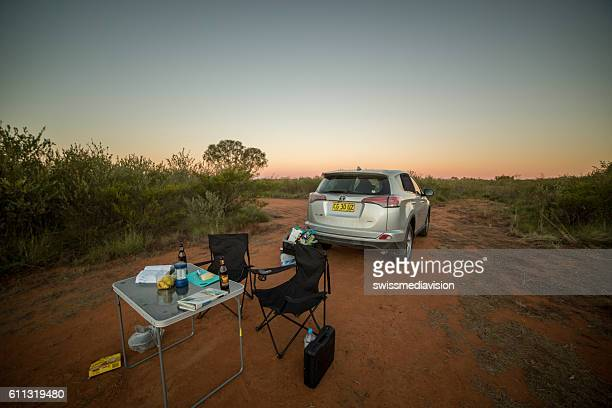 Camp set in the Australian outback at dusk