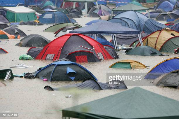 A camp site flooded by heavy rain on the first day of the Glastonbury Music Festival 2005 at Worthy Farm Pilton on June 23 2005 in Somerset England...