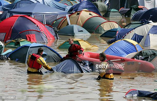 Camp site has flooded by heavy rain on the first day of the Glastonbury Music Festival 2005 at Worthy Farm Pilton on June 23 2005 in Somerset England...