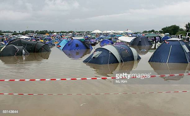 A camp site is flooded by heavy rain on the first day of the Glastonbury Music Festival 2005 at Worthy Farm Pilton on June 24 2005 in Glastonbury...
