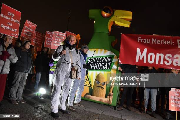 Campact activists protest against Agriculture Minister Christian Schmidt for voting for the usage extension of the controversial weedkiller...