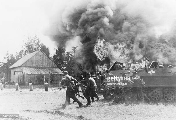2WW campaign against soviet union /eastern front Mechanized infantry protected by theit APC's advancing against a village July 1941