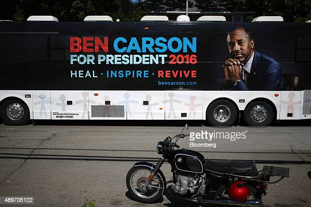 A campaign bus bearing the likeness of Ben Carson 2016 Republican presidential candidate not pictured sits parked near a campaign stop at the...