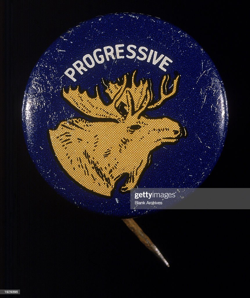 A campaign button for the Progressive party from the 1912 United States presidential election shows the head of the Bull Moose the mascot and...