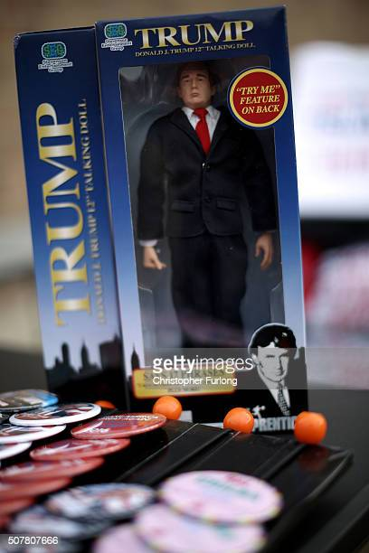 Campaign buttons and a Trump doll sit for sale before a Trump campaign rally at the Gerald W Kirn Middle School on January 31 2016 in Council Bluffs...
